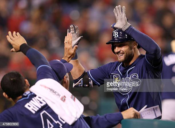Kevin Kiermaier of he Tampa Bay Rays celebrates as he returns to the dugout after leading off the tenth inning with a home run against the Los...