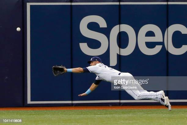 Kevin Kiermaier of the Rays dives in an attempt to catch a fly ball during the MLB regular season game between the New York Yankees and the Tampa Bay...