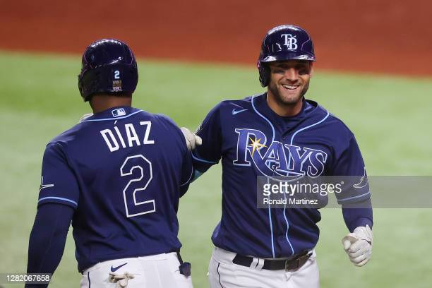 Kevin Kiermaier of the Tampa Bay Rays celebrates after hitting a solo home run against the Los Angeles Dodgers during the seventh inning in Game Four...