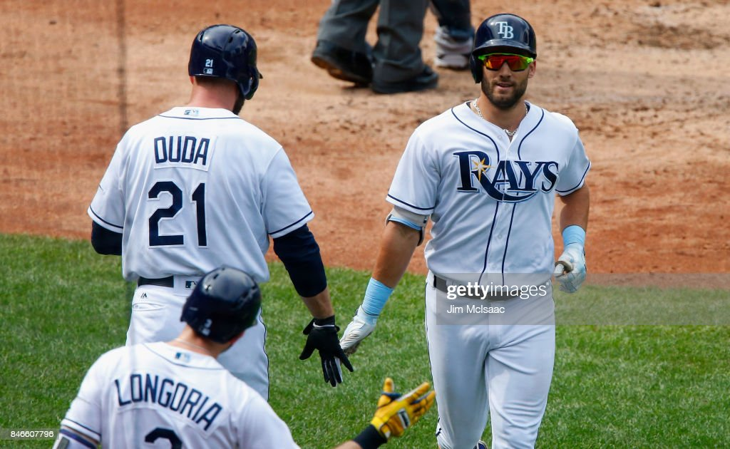 Kevin Kiermaier #39 of the Tampa Bay Rays celebrates his third inning home run against the New York Yankees with teammates Lucas Duda #21 and Evan Longoria #3 at Citi Field on September 13, 2017 in the Flushing neighborhood of the Queens borough of New York City. The two teams were scheduled to play in St. Petersburg, Florida but due to the weather emergency caused by Hurricane Irma, the game was moved to New York, but with Tampa Bay remaining the 'home' team.