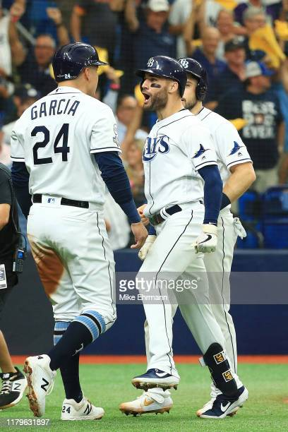 Kevin Kiermaier of the Tampa Bay Rays celebrates with Avisail Garcia after hitting a threerun home run against the Houston Astros during the second...