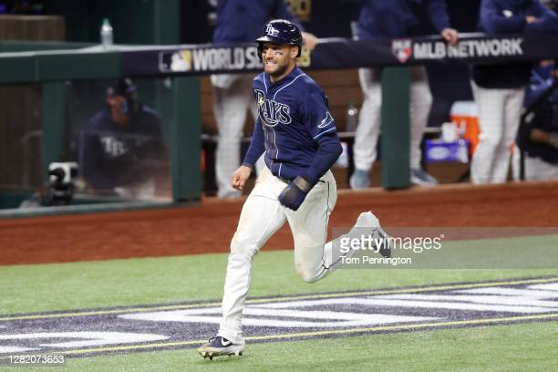 Kevin Kiermaier of the Tampa Bay Rays comes home to score a run on a single by Brett Phillips against the Los Angeles Dodgers during the ninth inning...