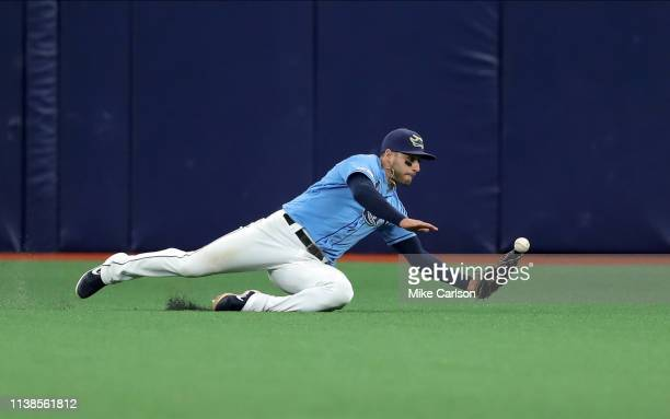 Kevin Kiermaier of the Tampa Bay Rays dives but unable to make a play on a line drive by Andrew Benintendi of the Boston Red Sox in the 10th inning...