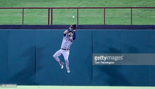 Kevin Kiermaier of the Tampa Bay Rays fields a fly ball hit by Robinson Chirinos of the Texas Rangers for the out in the bottom of the third inning...