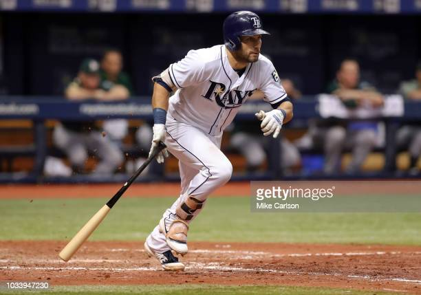 Kevin Kiermaier of the Tampa Bay Rays follows through on his RBI triple in the sixth inning of a baseball game against the Oakland Athletics at...