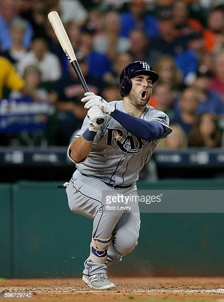 Kevin Kiermaier of the Tampa Bay Rays fouls ball off his groin against the Houston Astros at Minute Maid Park on August 27 2016 in Houston Texas