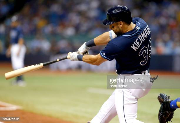 Kevin Kiermaier of the Tampa Bay Rays hits an RBI single off of pitcher Jon Lester of the Chicago Cubs by score Brad Miller during the second inning...