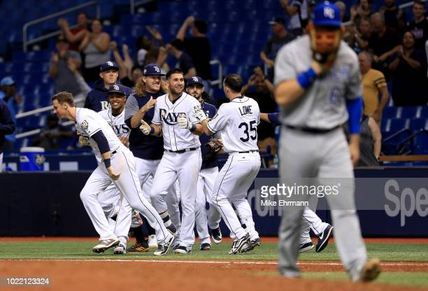 Kevin Kiermaier of the Tampa Bay Rays is congratluated after hitting into a walk off force attempt throwing error by Ryan O'Hearn of the Kansas City...
