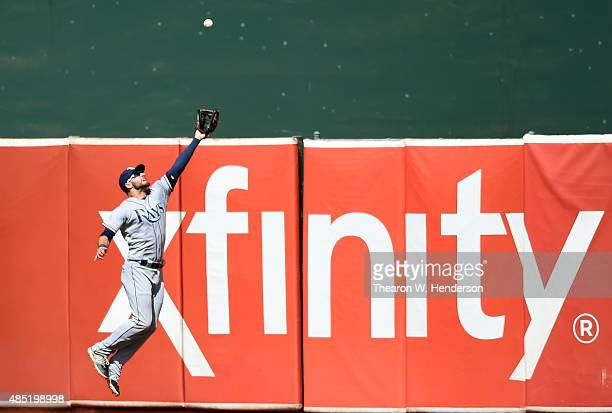 Kevin Kiermaier of the Tampa Bay Rays leaps and watches the ball go over his glove for a bases loaded threerun rbi triple off the bat of Mark Canha...