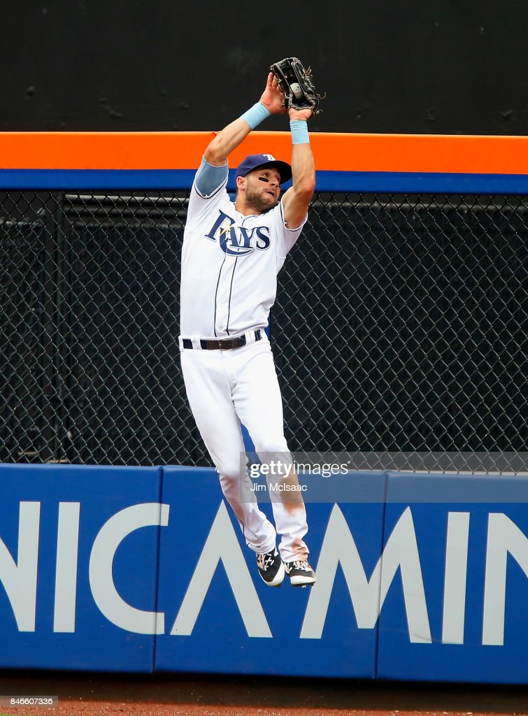 Kevin Kiermaier #39 of the Tampa Bay Rays makes a catch at the wall for an out in the sixth inning against the New York Yankees at Citi Field on September 13, 2017 in the Flushing neighborhood of the Queens borough of New York City. The two teams were scheduled to play in St. Petersburg, Florida but due to the weather emergency caused by Hurricane Irma, the game was moved to New York, but with Tampa Bay remaining the 'home' team.