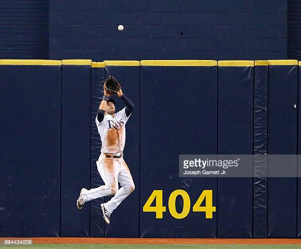 Kevin Kiermaier of the Tampa Bay Rays makes a catch in the outfield during the ninth inning of the game with the Boston Red Sox at Tropicana Field on...