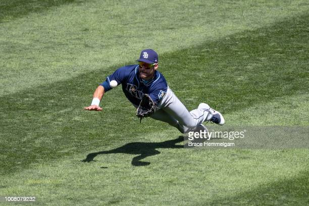 Kevin Kiermaier of the Tampa Bay Rays makes a diving catch against the Tampa Bay Rays on July 15, 2018 at Target Field in Minneapolis, Minnesota. The...