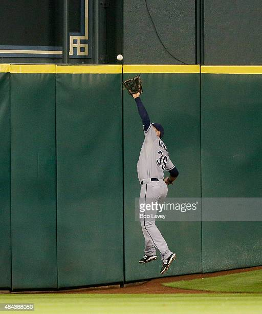 Kevin Kiermaier of the Tampa Bay Rays makes a leaping catch near the wall on a deep fly ball from Carlos Gomez of the Houston Astros in the sixth...
