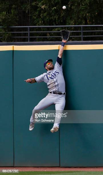 Kevin Kiermaier of the Tampa Bay Rays makes a leaping catch to get out Jason Kipnis of the Cleveland Indians during the ninth inning at Progressive...