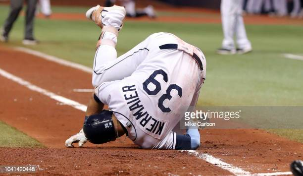 Kevin Kiermaier of the Tampa Bay Rays reacts after being hit in the foot by a pitch from Masahiro Tanaka of the New York Yankees in the first inning...