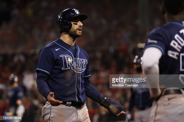 Kevin Kiermaier of the Tampa Bay Rays reacts after his ground rule double in the 13th inning against the Boston Red Sox during Game 3 of the American...