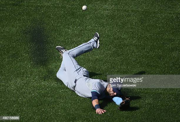 Kevin Kiermaier of the Tampa Bay Rays slides but cannot get to an RBI double hit by Kevin Pillar of the Toronto Blue Jays in the third inning during...