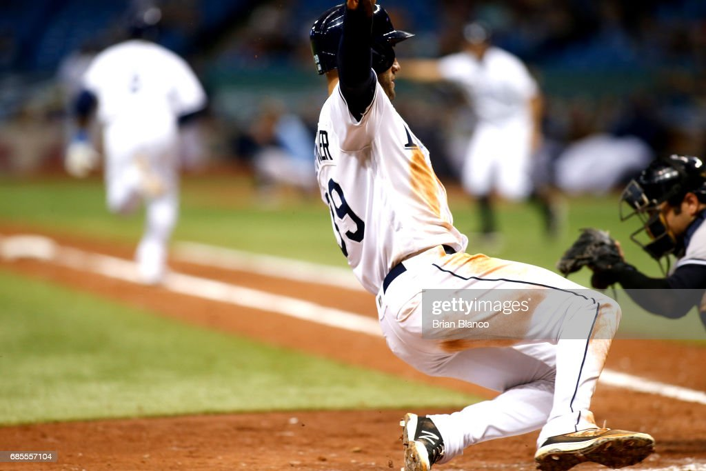 Kevin Kiermaier #39 of the Tampa Bay Rays slides home ahead of catcher Austin Romine #27 of the New York Yankees to score off of a two-run double by Rickie Weeks during the seventh inning of a game on May 19, 2017 at Tropicana Field in St. Petersburg, Florida.