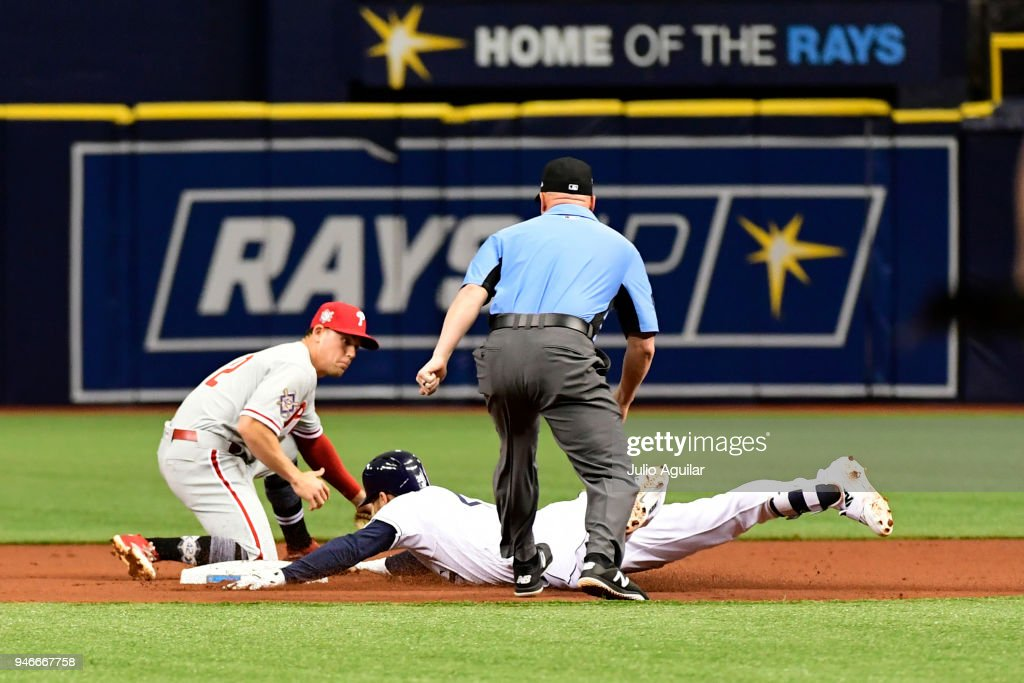 Kevin Kiermaier #39 of the Tampa Bay Rays slides to second base on an error by Rhys Hoskins #17 of the Philadelphia Phillies on April 15, 2018 at Tropicana Field in St Petersburg, Florida. All players are wearing #42 in honor of Jackie Robinson Day.