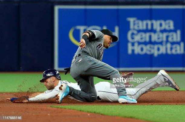 Kevin Kiermaier of the Tampa Bay Rays steals second as Ildemaro Vargas of the Arizona Diamondbacks applies the tag in the third inning during a game...