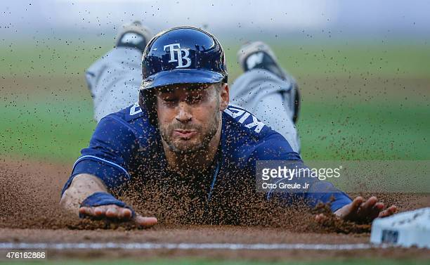 Kevin Kiermaier of the Tampa Bay Rays steals third base in the first inning against the Seattle Mariners at Safeco Field on June 6 2015 in Seattle...