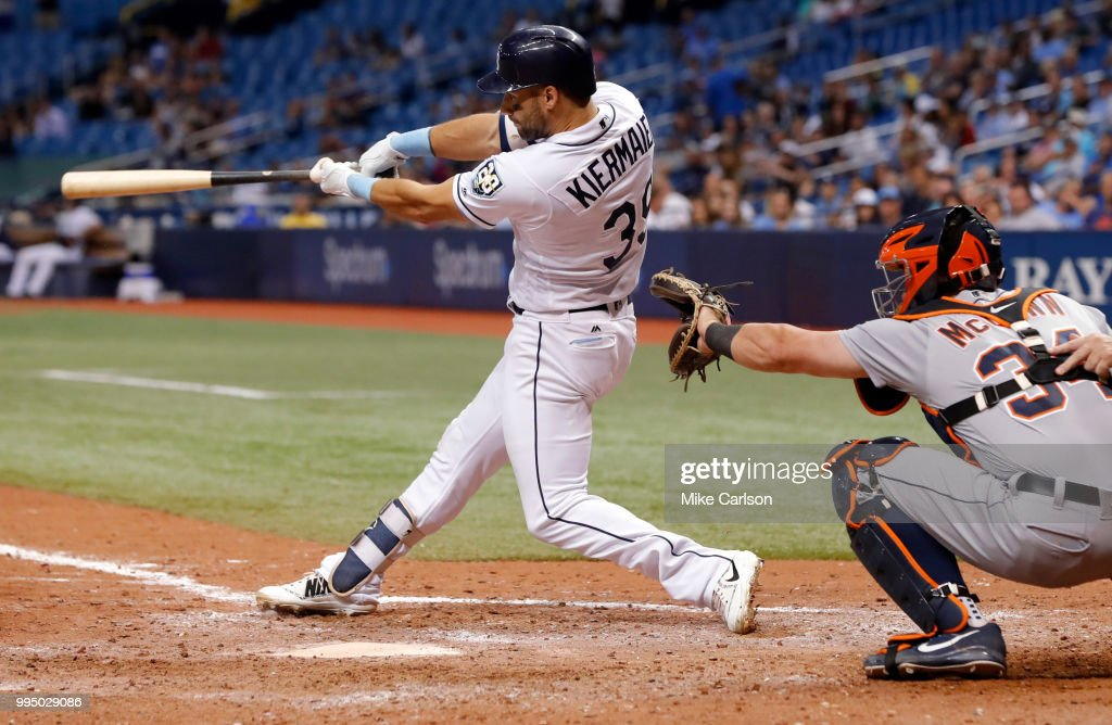 Kevin Kiermaier #39 of the Tampa Bay Rays triples in front of James McCann #34 of the Detroit Tigers in the 10th inning of a baseball game at Tropicana Field on July 9, 2018 in St. Petersburg, Florida.