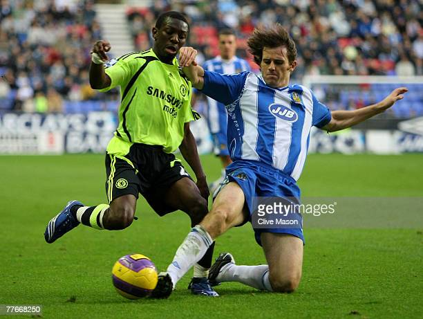 Kevin Kilbane of Wigan Athletic is challenged by Shaun WrightPhillips of Chelsea during the Barclays Premier League match between Wigan Athletic and...