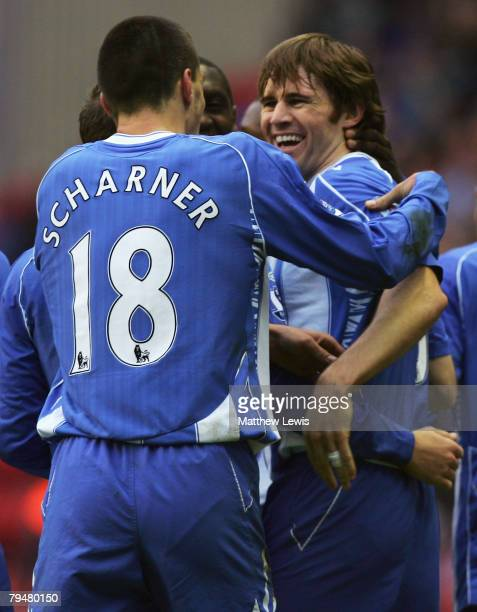 Kevin Kilbane of Wigan celebrates his goal with Paul Scharner during the Barclays Premier League match between Wigan Athletic and West Ham United at...