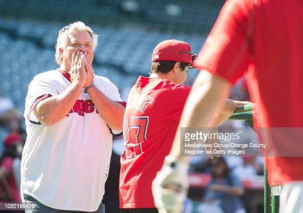 Kevin Kincade of Westminster looks overwhelmed while watching batting practice with his son Mike during a visit to Angel Stadium Tuesday INFO...