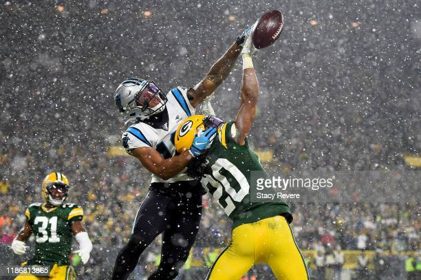 Kevin King of the Green Bay Packers breaks up a pass intended for D.J. Moore of the Carolina Panthers during the fourth quarter in the game at...