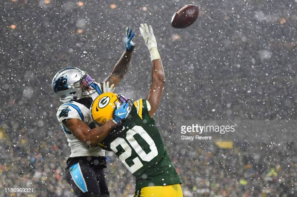 Kevin King of the Green Bay Packers defends a pass intended for DJ Moore of the Carolina Panthers during a game at Lambeau Field on November 10 2019...