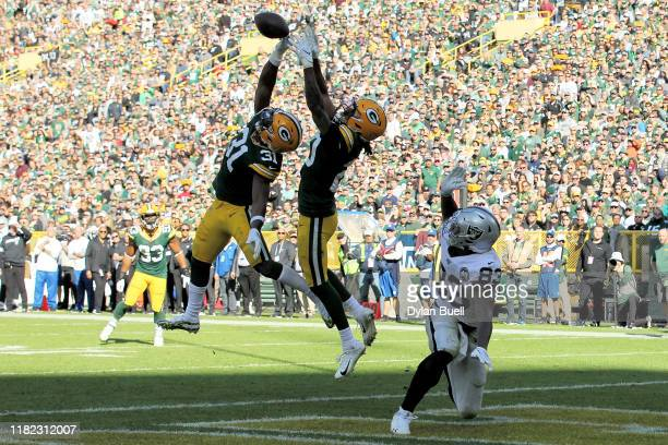 Kevin King of the Green Bay Packers makes an interception on a pass intended for Darren Waller of the Oakland Raiders in the fourth quarter at...