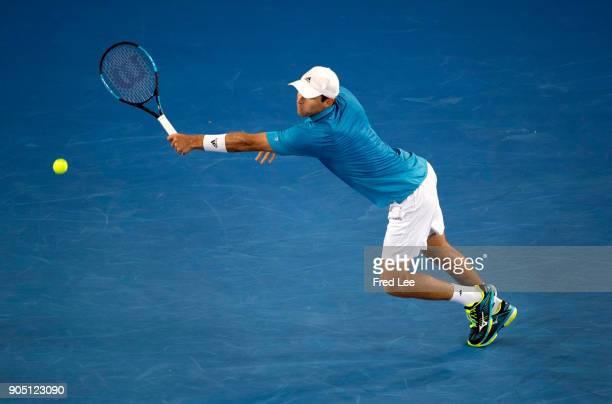 Kevin King of the United States plays a backhand volley in his first round match against JoWilfried Tsonga of France on day one of the 2018...