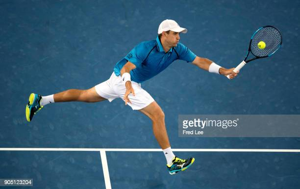 Kevin King of the United States plays a forehand volley in his first round match against JoWilfried Tsonga of France on day one of the 2018...