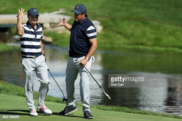 Kevin Kisner and Phil Mickelson of the US Team celebrate on the first green after going one up against Jason Day and Marc Leishman of Australia and...