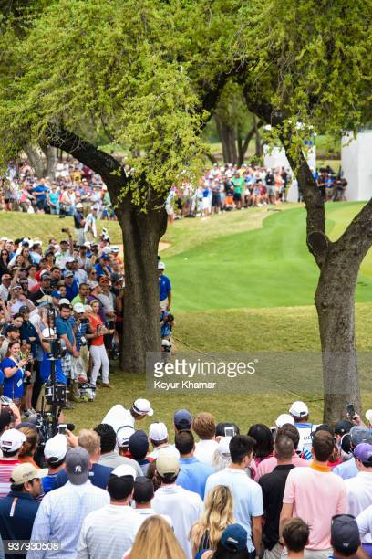 Kevin Kisner chips a shot between the trees to the sixth hole green as fans watch during the championship match at the World Golf ChampionshipsDell...