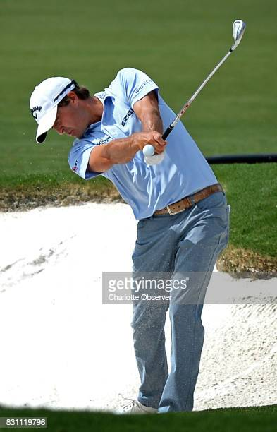 Kevin Kisner hits his second shot from a sand trap along the fifth fairway during final round action of the PGA Championship at Quail Hollow Club in...
