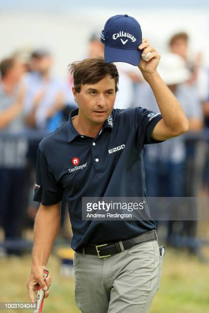 Kevin Kisner of the United States acknowledges the crowd on the 18th green during the third round of the 147th Open Championship at Carnoustie Golf...