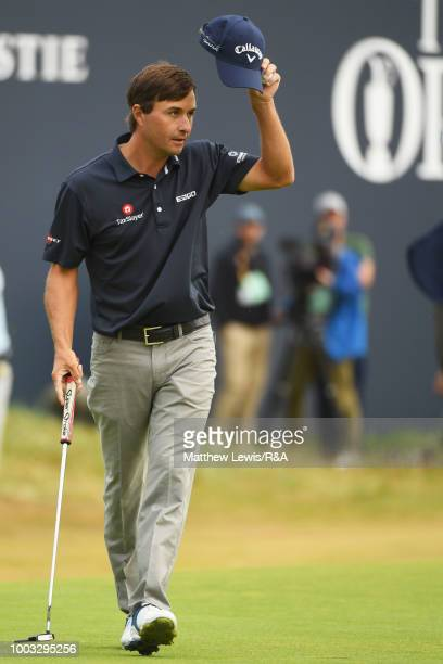 Kevin Kisner of the United States acknowledges the crowd on the 18th hole green following round three of the Open Championship at Carnoustie Golf...