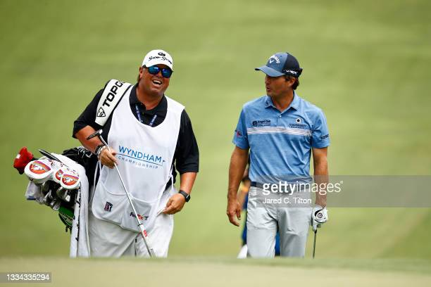 Kevin Kisner of the United States and caddie Duane Bock walk up the 18th fairway, the first-playoff hole in a six-way sudden-death playoff, during...