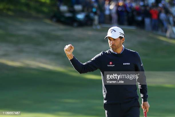 Kevin Kisner of the United States celebrates after defeating Matt Kuchar of the United States 32 during the final round of the World Golf...