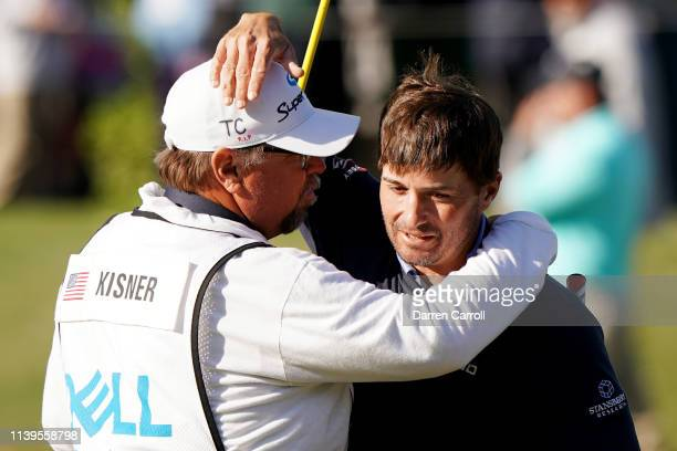 Kevin Kisner of the United States celebrates with his caddie Duane Bock after defeating Matt Kuchar of the United States 32 during the final round of...