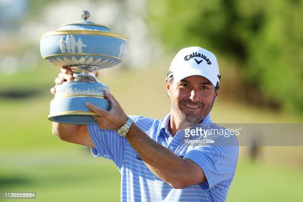 Kevin Kisner of the United States celebrates with the Walter Hagen Cup after defeating Matt Kuchar of the United States 3&2 during the final round of...