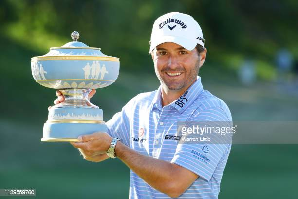 Kevin Kisner of the United States celebrates with the Walter Hagen Cup after defeating Matt Kuchar of the United States 32 during the final round of...