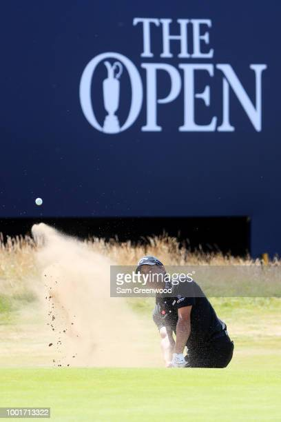Kevin Kisner of the United States hits a bunker shot on the 18th hole during the first round of the 147th Open Championship at Carnoustie Golf Club...