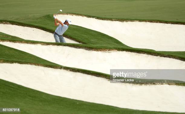 Kevin Kisner of the United States plays a shot from a bunker on the fifth hole during the final round of the 2017 PGA Championship at Quail Hollow...