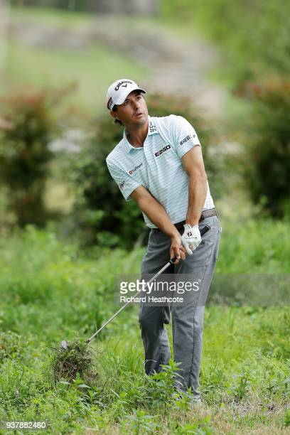 Kevin Kisner of the United States plays his second shot on the fifth hole during his final round match against Bubba Watson of the United States in...
