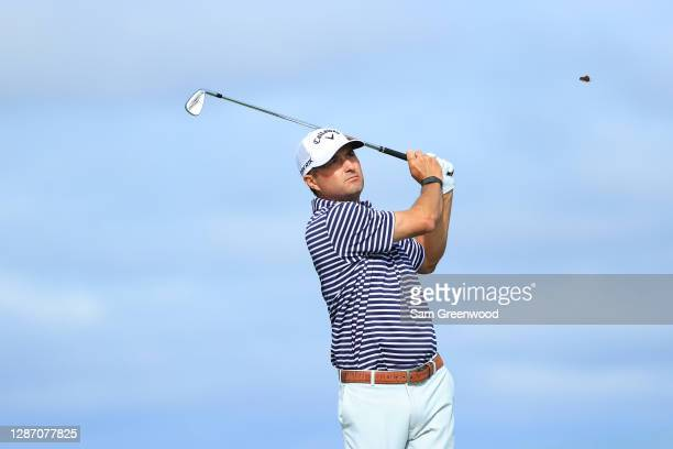 Kevin Kisner of the United States plays his shot from the sixth tee during the final round of The RSM Classic at the Seaside Course at Sea Island...