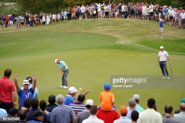 Kevin Kisner of the United States putts on the 16th green during his semifinal round match against Alexander Noren of Sweden in the World Golf...