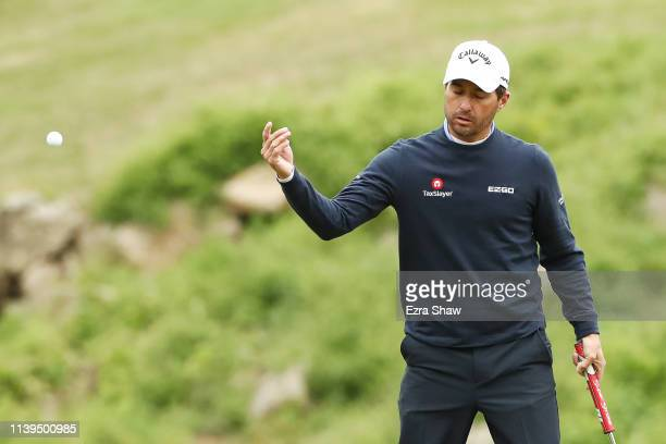 Kevin Kisner of the United States reacts on the ninth green in his match against Francesco Molinari of Italy during the semifinal round of the World...